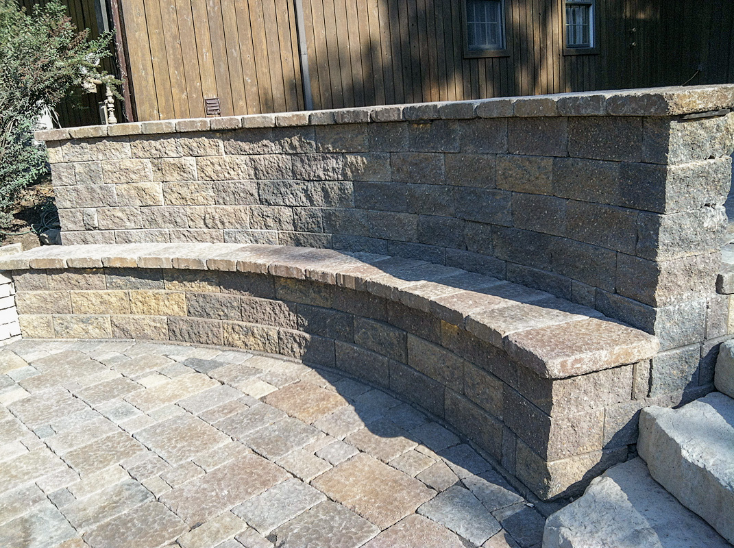 Landscape Design by Auman Landscape LLC. Installation in Lancaster Ohio at a Fairfield County Ohio Brewery. Paver patio with Seat wall connection