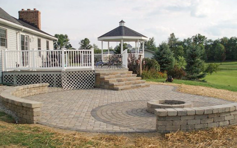 Landscape Design by Auman Landscape LLC. Installation in Lancaster, Ohio. Paver Patio Fairfield County Ohio. Fire pit and circle pack pavers.