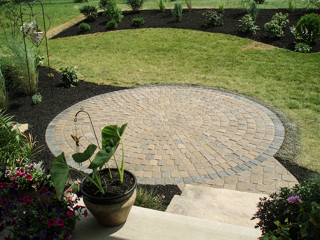 Landscape Design by Auman Landscape LLC. Installation in Lancaster, Ohio. Paver Patio in Fairfield County Ohio. Circular Patio Design.