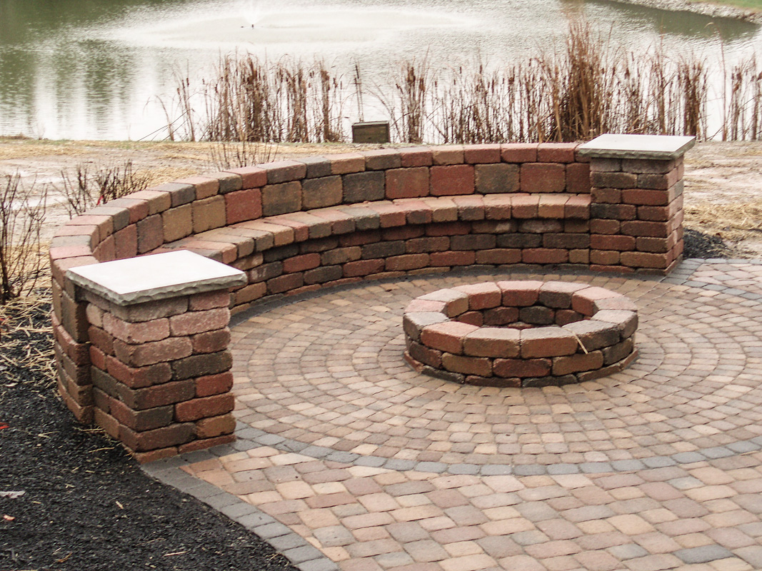 Landscape Design by Auman Landscape LLC. Installation in Fairfield County Ohio. Paver Patio in Lancaster, Ohio. Seat wall and fire pit display.