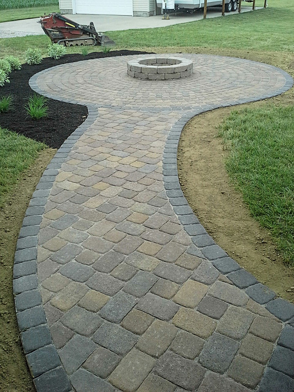 Landscape Design by Auman Landscape LLC. Installation in Fairfield County Ohio. Patio installed in Bremen, Ohio. paver Patio. Paver Sidewalk. Paver fire pit. Landscape Installation. Planting Installation. Mulching