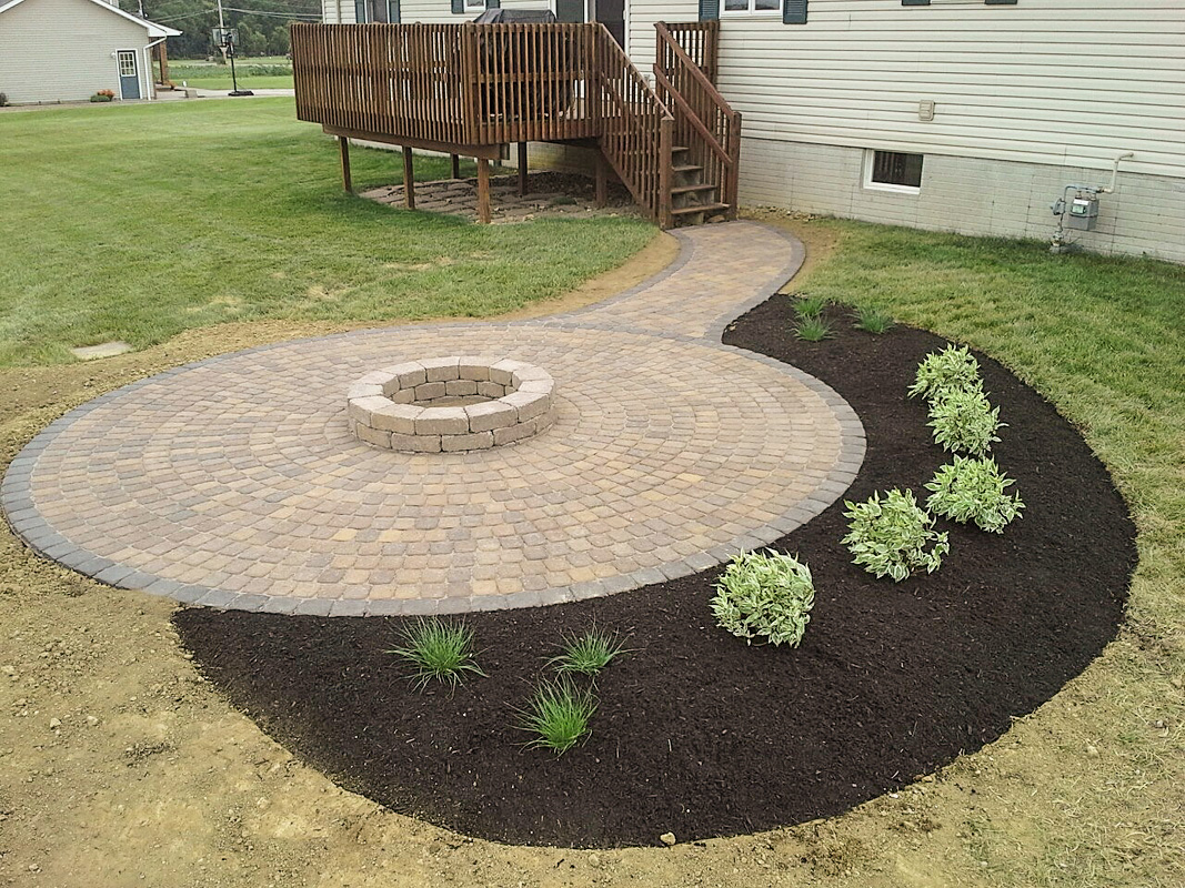 Landscape Design by Auman Landscape LLC. Installation in Lancaster, Ohio. Paver Patio in Fairfield County Ohio. Landscape Planting. Planting Installation. Mulching.