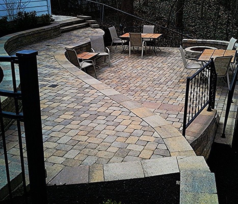 Landscape Design by Auman Landscape LLC. Installation in Fairfield County Ohio. Lancaster, OHIO. Paver Patio. Fire pit. Versa-lok retaining wall.