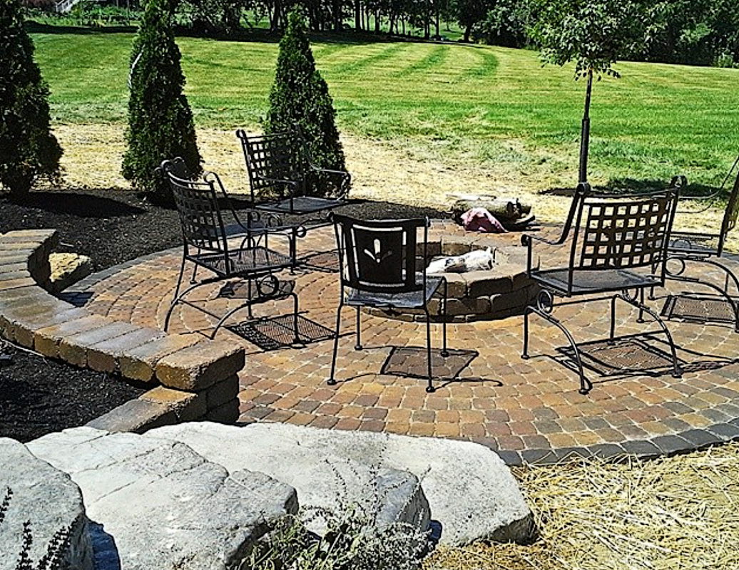 Landscape Design by Auman Landscape LLC. Installation in Fairfield County Ohio. Paver Patio. Fire pit. Seat wall. Oberfields LLC