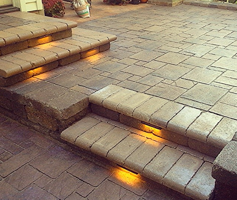 Landscape Design by Auman Landscape LLC. Paver steps. LED Lighting. Paver Patio. Unilock Pavers