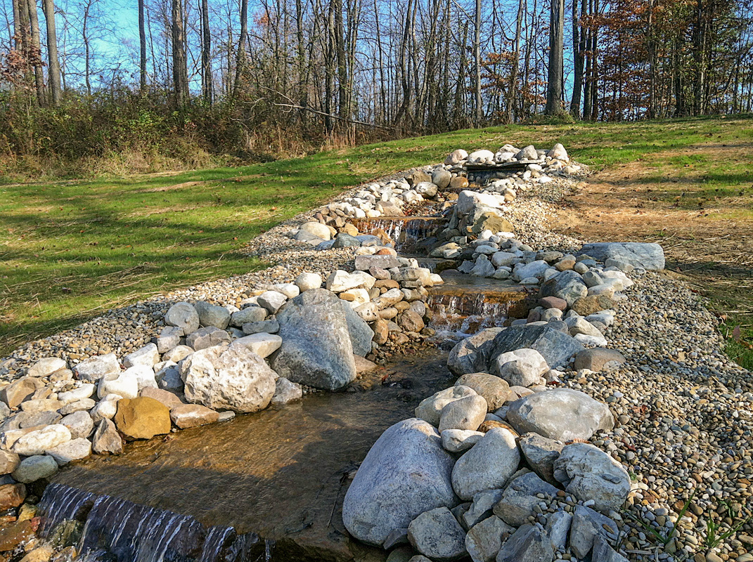 Landscape Design by Auman Landscape LLC. Waterfall/Stream in Fairfield County Ohio built by Auman Landscape LLC